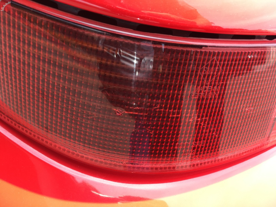 LEFT TAIL LAMP CRACKS