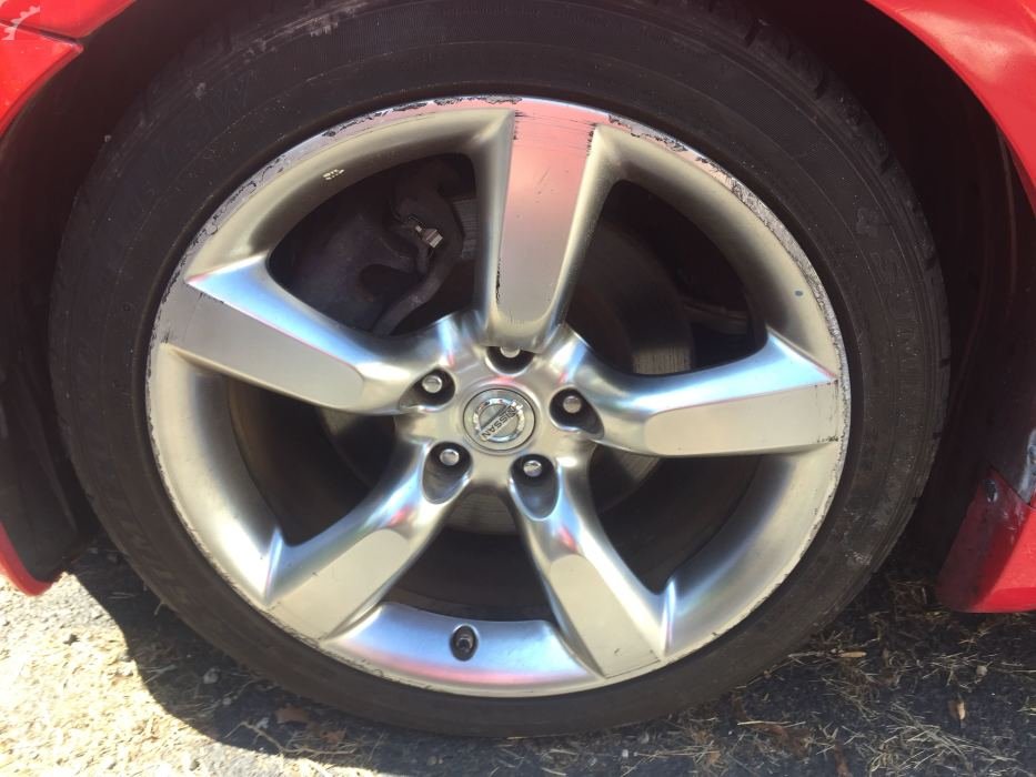 LEFT FRONT WHEEL W/ CURB RASH