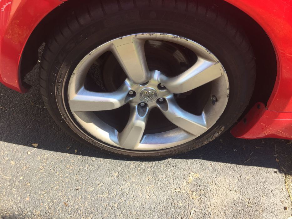 RIGHT REAR WHEEL W/ CURB RASH