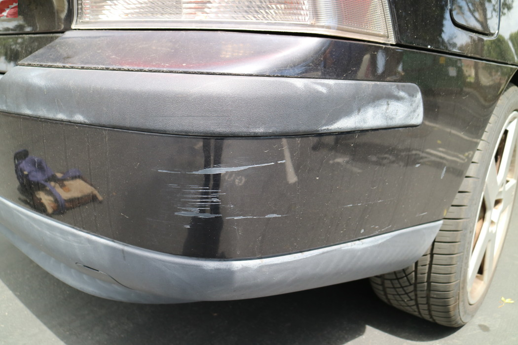 SCRATCHES RIGHT REAR BUMPER