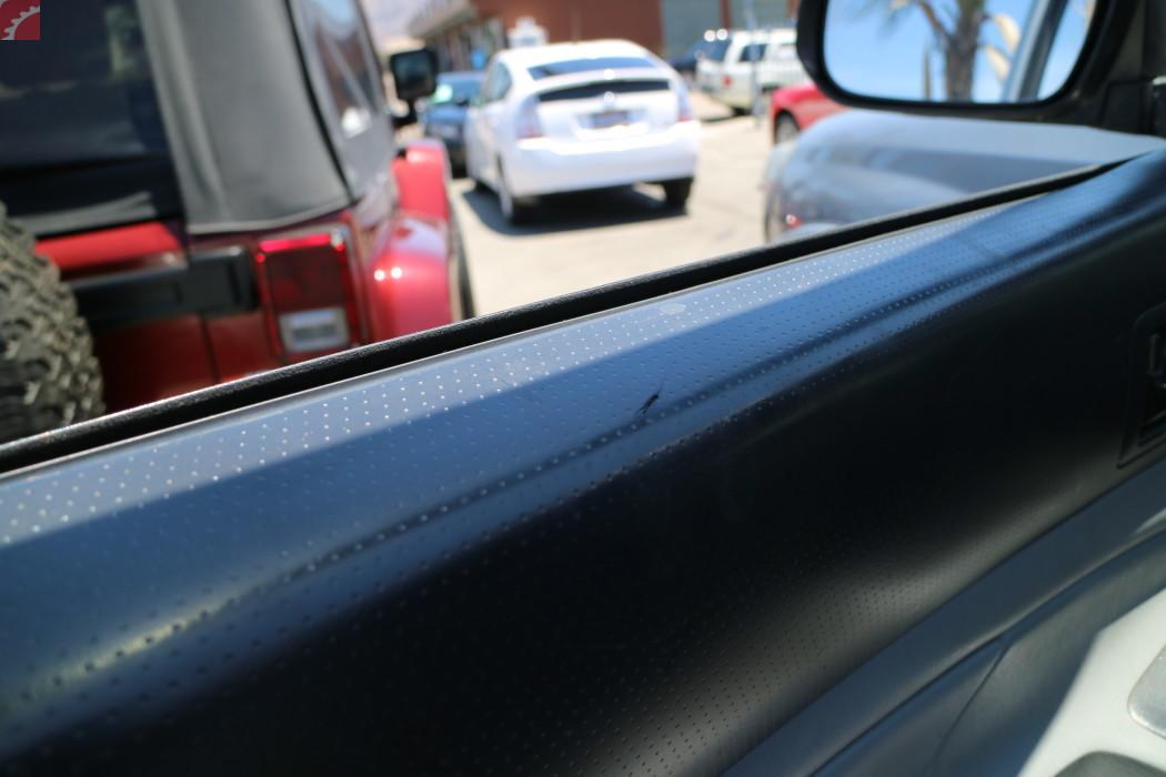 DRIVER DOOR TRIM SCRATCHED
