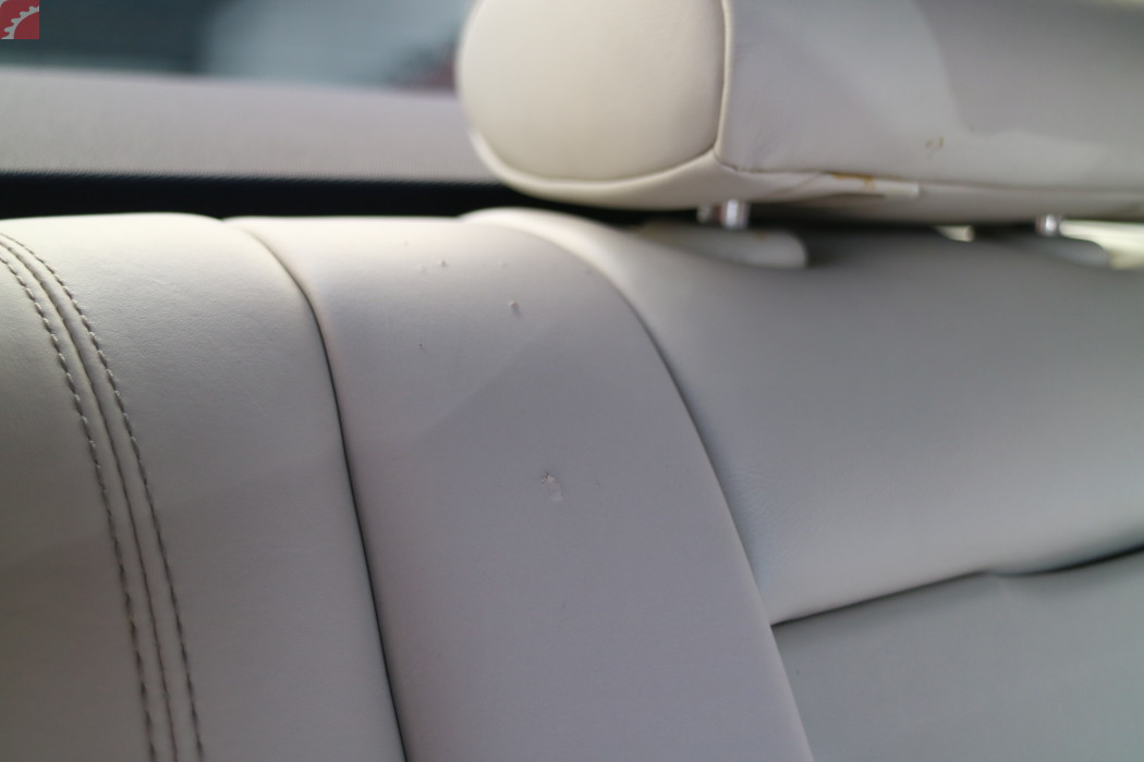 REAR SEAT LEATHER SCRATCHED