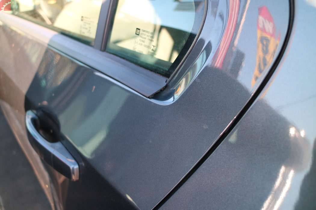 LEFT REAR DOOR  WINDOW TRIM LOOSE