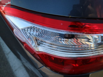 LEFT TAIL LAMP CRACKED
