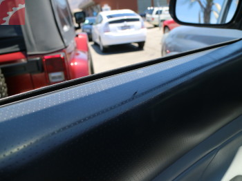 DRIVER DOOR TRIM SCRATCHED
