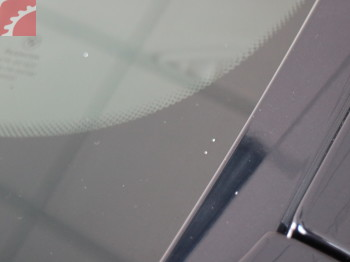 SMALL ROCK CHIPS DRIVER SIDE WINDSHIELD, NOT IN DRIVERS VIEW