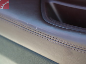 WEAR ON DRIVER DOOR PANEL LEATHER
